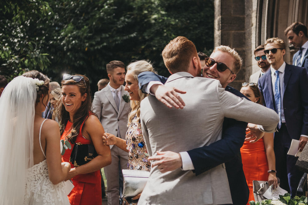 guests celebrate with bride and groom after derby wedding ceremony