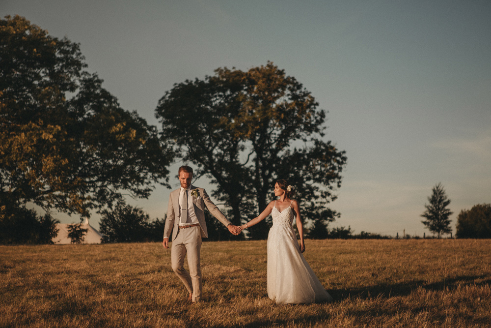 bride and groom walking in Derbyshire with their wedding photographers