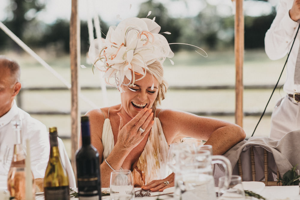 mother of groom laughing at best man's speech