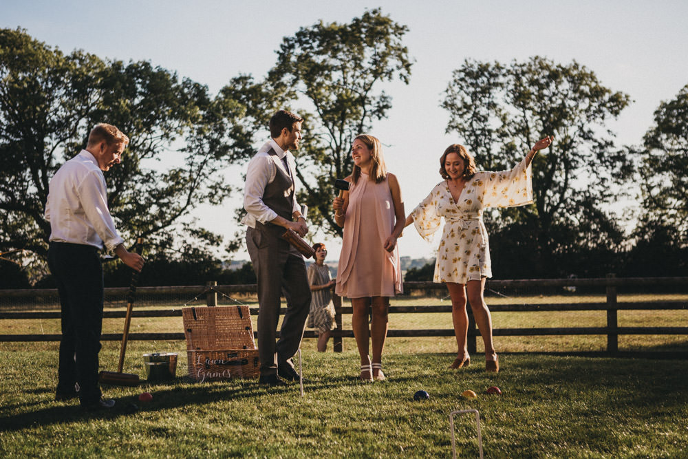 guests playing garden games at outdoor wedding reception