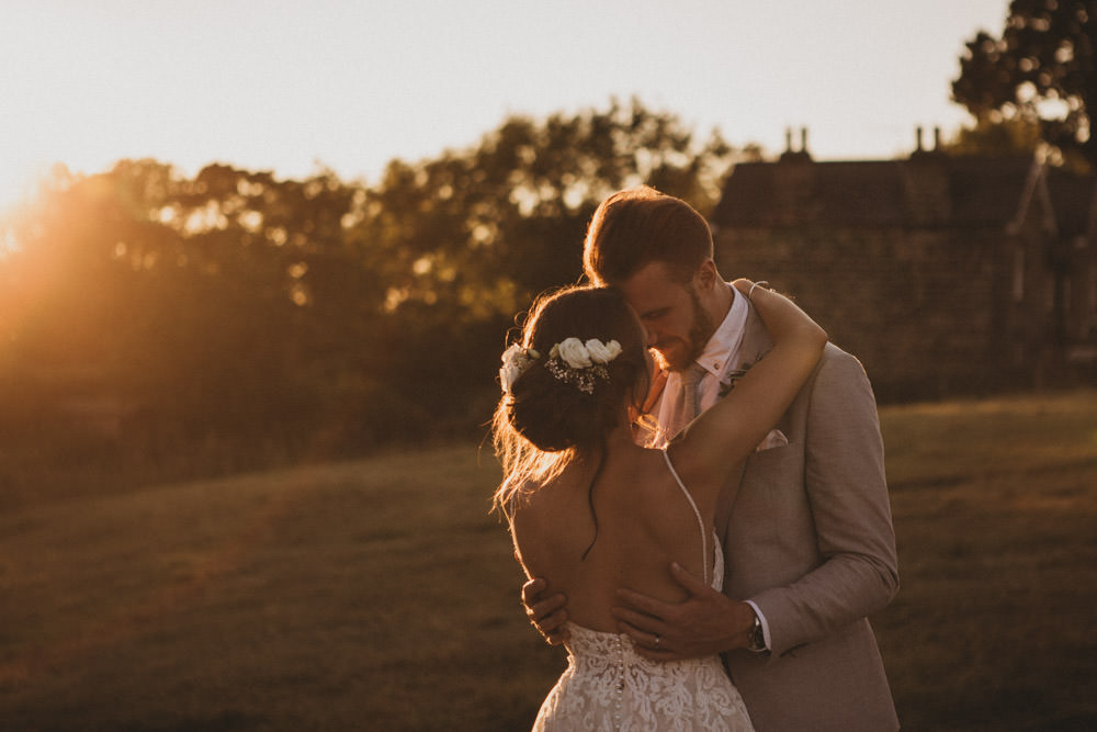 sunset wedding photos of bride and groom by Derbyshire wedding photographers