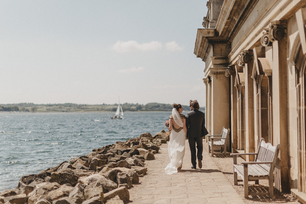 Rutland Normanton Church wedding photo with bride and groom walking together