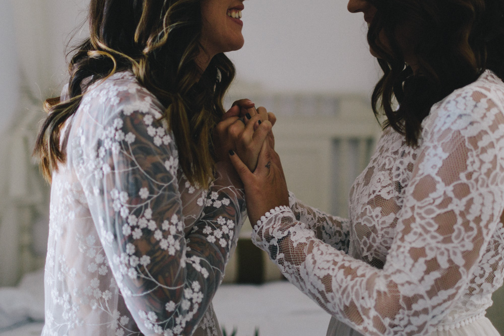 same sex wedding couple holding hands