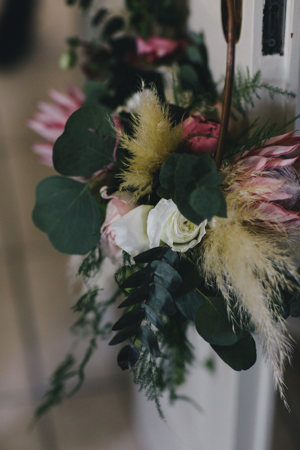 bouquet with peonies, roses, greenery and pampas grass