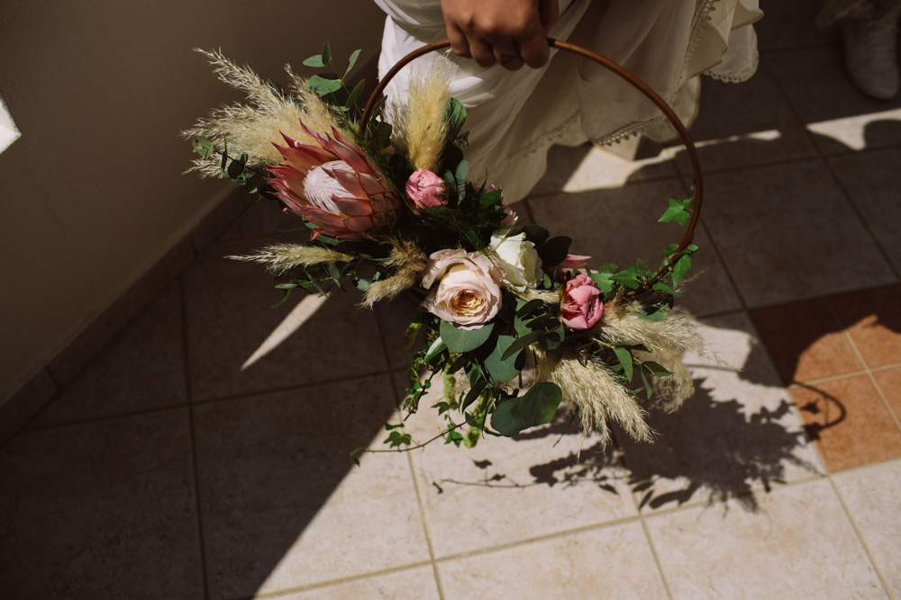 Brides bouquet with peonies, roses, greenery and pampas grass