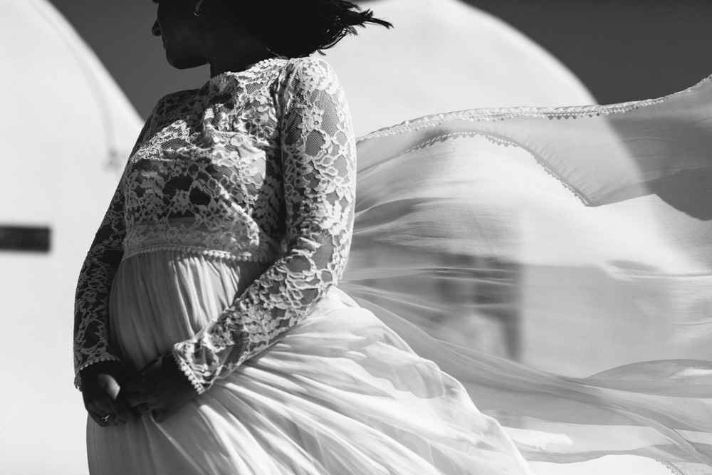Lace wedding dress blowing in wind