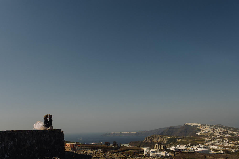 Brides wearing leather jackets in Santorini photo shoot