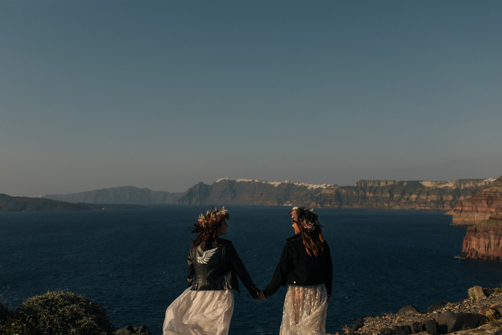 Wedding couple in Santorini wearing lace dresses