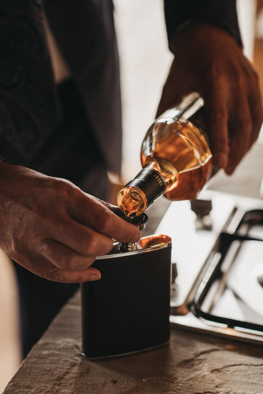 Whiskey being poured at Scottish wedding