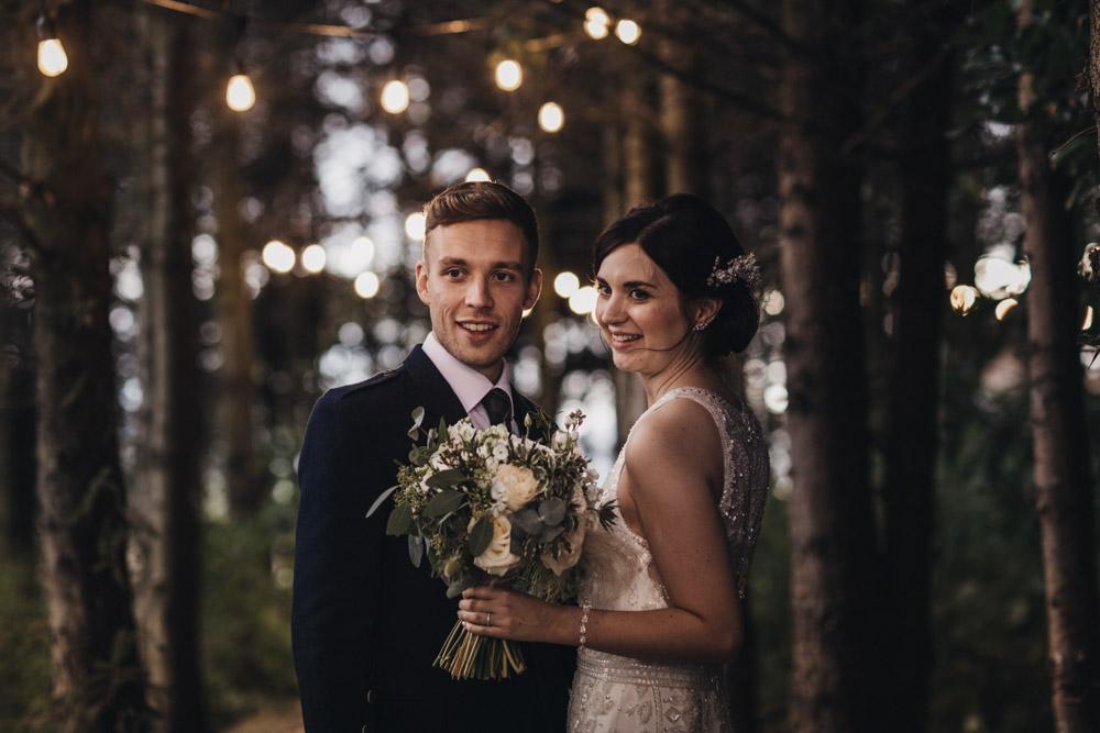Bride wearing sleeveless wedding dress